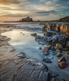 First Light At Bamburgh By Phillip Dove